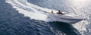 Couple enjoy boating on sleek vessel - Adventure Marine Lifestyle