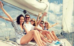 Happy crew aboard boat - Adventure Marine