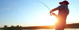 Man fishing at sunset, Adventure Marine