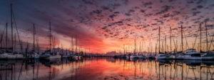 Marina at sunset with bright orange and reds - Adventure Marine Lifestyle