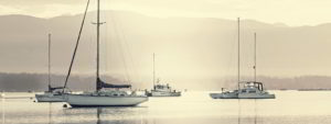 Sailboats in a quiet harbour - Adventure Marine Lifestyle
